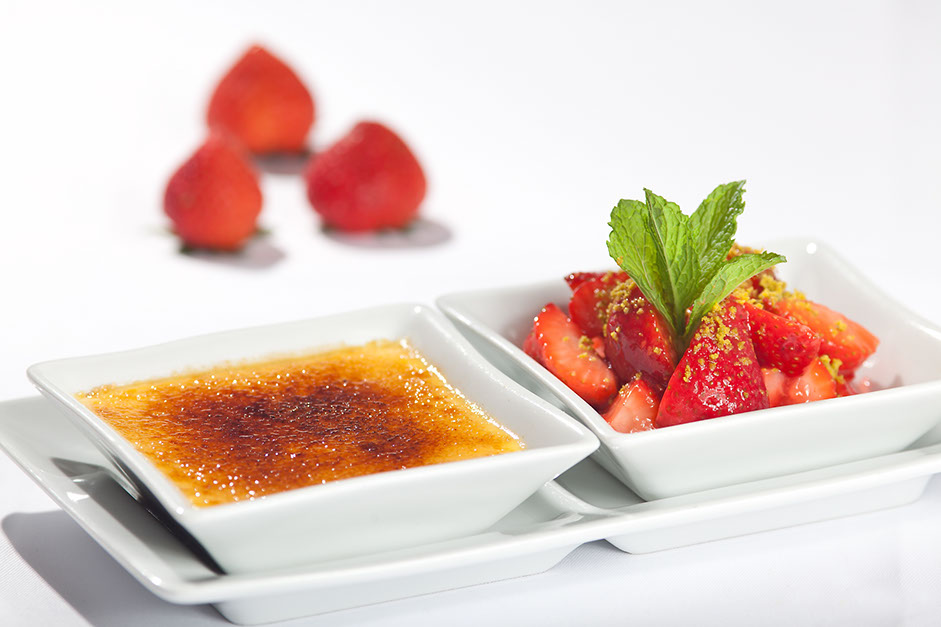 Crème brûlée with marinated strawberries. Delicious desserts from the restaurant oliv in basel.