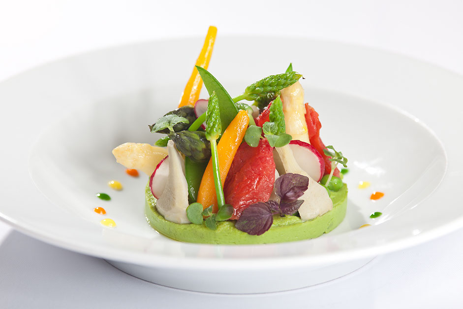 Small vegetables on green pea puree