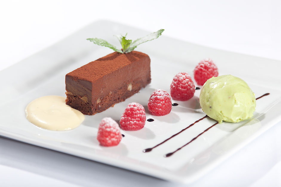 Chocolate cake with raspberries and pistacchio ice-cream. Desserts from the restaurant oliv in basel.